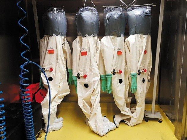 Hazmat suits in a level 4 lab